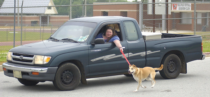 "Seen this lady in a huge school parking lot. <br /> <br /> She seen me taking pics of her and smiled and laughed as she drove by me saying  ""this is how you do it"".<br /> <br />  I was there for 25 minutes and she was still ""walking her dog"" when I left... <br /> <br /> Wow is all I can say.."