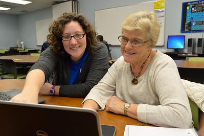 Casa tutor Kailin Johnson assits student Phyllis Loeffler with Excel Program.