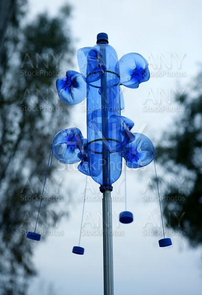 blue bottle of plastic used as handcraft weathercock
