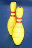 Bowling in yellow color still life blue background