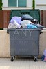 Trash garbage full container in street