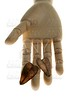 Mannequin wooden hand holding autumn brown leaves