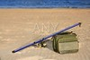 Fishing surfcasting rod and box over beach sand