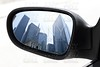 rearview car driving mirror view city downtown