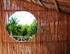circle window in wooden sticks cabin tropical Jungle