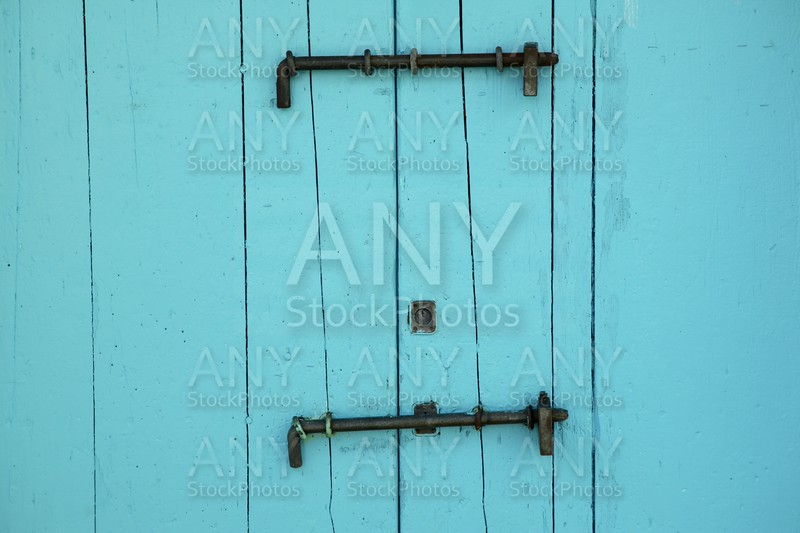 Aged wooden color door in mediterranean