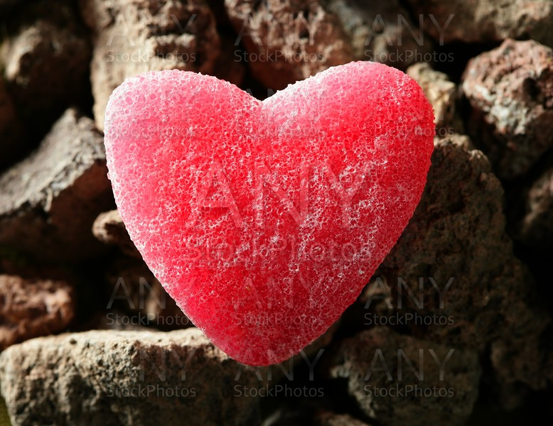 Candy jelly read heart over stones