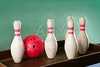 Bowling still life red ball over green background