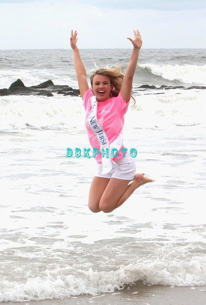 OCEAN CITY, NJ - JUNE 16:  NJ  Lindsey Petrosh, Miss Atlantic County, 23, from Egg Harbor City leaps with joy in the ocean next to the Ocean City Music Pier,  on June 16, 2012 in Ocean City, New Jersey.