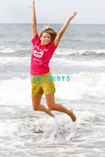Ocean City, NJ - Miss New Jersey 2011, Katharyn Nicolle, age 20, leaps in the ocean on Sunday June 19, 2011 after being crowned the previous evening.