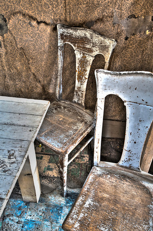 Abandoned kitchen, white chairs and table