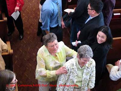 Juanita and Peggy greet guests