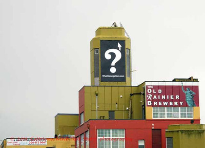"""What's missing?  The neon lit """"T"""" is gone.  The """"R"""" for Rainier beer is going to return atop the former brewery building."""