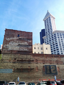 Old building sign with Smith Tower in background