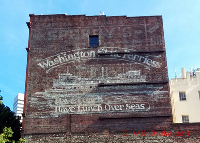 "Old building with sign that may soon be a ""ghost sign"""