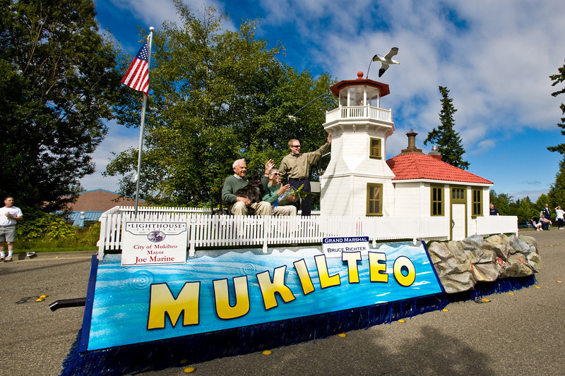 Mukilteo Mayor Joe Marine waves with Grand Marshall Bruce Richter and Tude Richter during the Mukilteo Float's very first public outing!