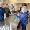 Community volunteers and parish members prepare meals for community members in need.