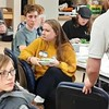 """AmeriCorps Member and activity organizer Thalia Sweeney enjoys a plate of """"bucket of brains,"""" a special pasta lunch that was served to those in attendance."""