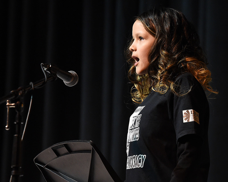 "Jaya Rodriguez, a Garfield Elementary fifth-grader, reads her essay ""Equality for Love"" during the Martin Luther King Jr. Community Celebration Monday, Jan. 16, 2017, at Mountain View High School in Loveland. (Photo by Jenny Sparks/Loveland Reporter-Herald)"