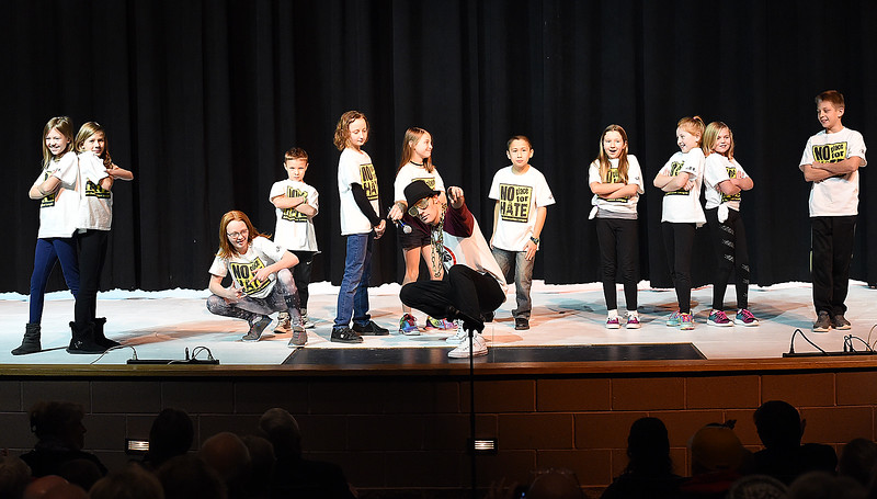"Brandon Harrington and students in the Sarah Milner Elementary No Place for Hate Coalition perform ""Power of Anti-Bullying"" during the Martin Luther King Jr. Community Celebration Monday, Jan. 16, 2017, at Mountain View High School in Loveland. (Photo by Jenny Sparks/Loveland Reporter-Herald)"
