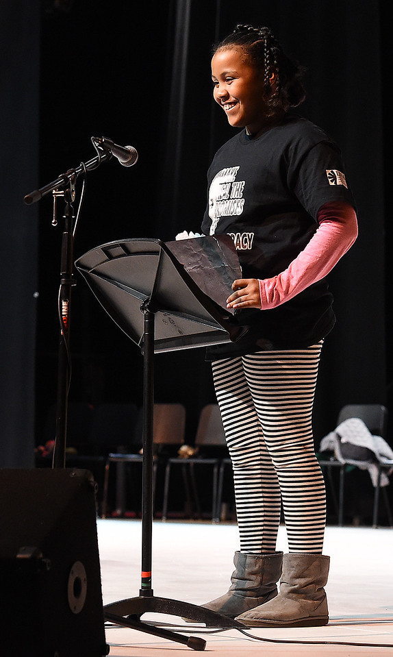 "Janaya Battoms, Garfield Elemetnary fifth-grader, reads her part of ""Collage in Contrast-In My Words"" during the Martin Luther King Jr. Community Celebration Monday, Jan. 16, 2017, at Mountain View High School in Loveland. (Photo by Jenny Sparks/Loveland Reporter-Herald)"