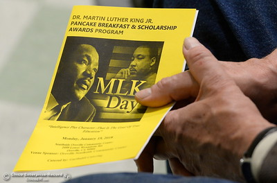 A man holds a program during the Martin Luther King Jr. day celebration at the Southside Community Center in Oroville, Calif. Mon. Jan. 15, 2018. (Bill Husa -- Enterprise-Record)