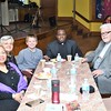 Sonya Green, Paulette Veardmore, Raymond Veardmore, Father Anthony Mpagi, and Richard Veardmore, from left, during the MLK Jr. celebration at Leominster's First Church on Monday. SENTINEL & ENTERPRISE/JIM FAY