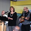 Mickey Guzman, Paula Cookson Luria and Paul Luria, from left, performed and led singalongs during the MLK Jr. celebration at Leominster's First Church on Monday. SENTINEL & ENTERPRISE/JIM FAY