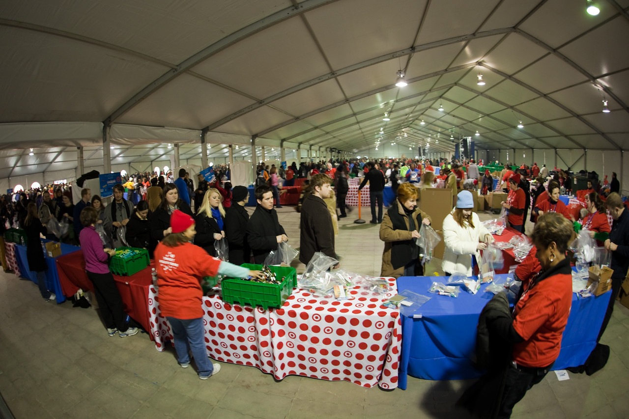 Volunteers assemble care packages for soldiers during the Operation Gratitude event held in RFK Stadium in Washington, DC, during 2009 Martin Luther King Day observances.