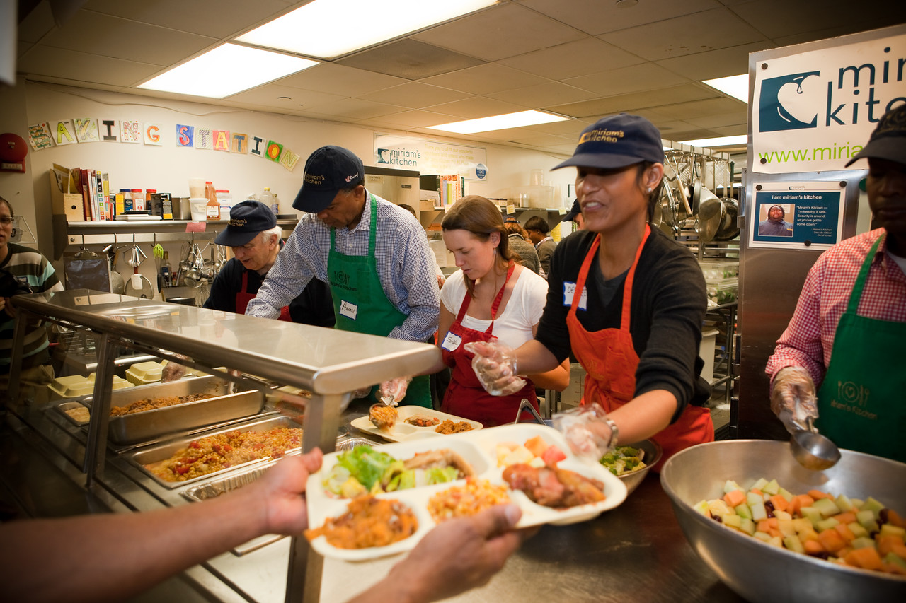 MLK Day, January 18, 2010: Peace Corps Director Aaron S. Williams, second from left, prepares plates of food to serve to homeless people at Miriam's Kitchen.