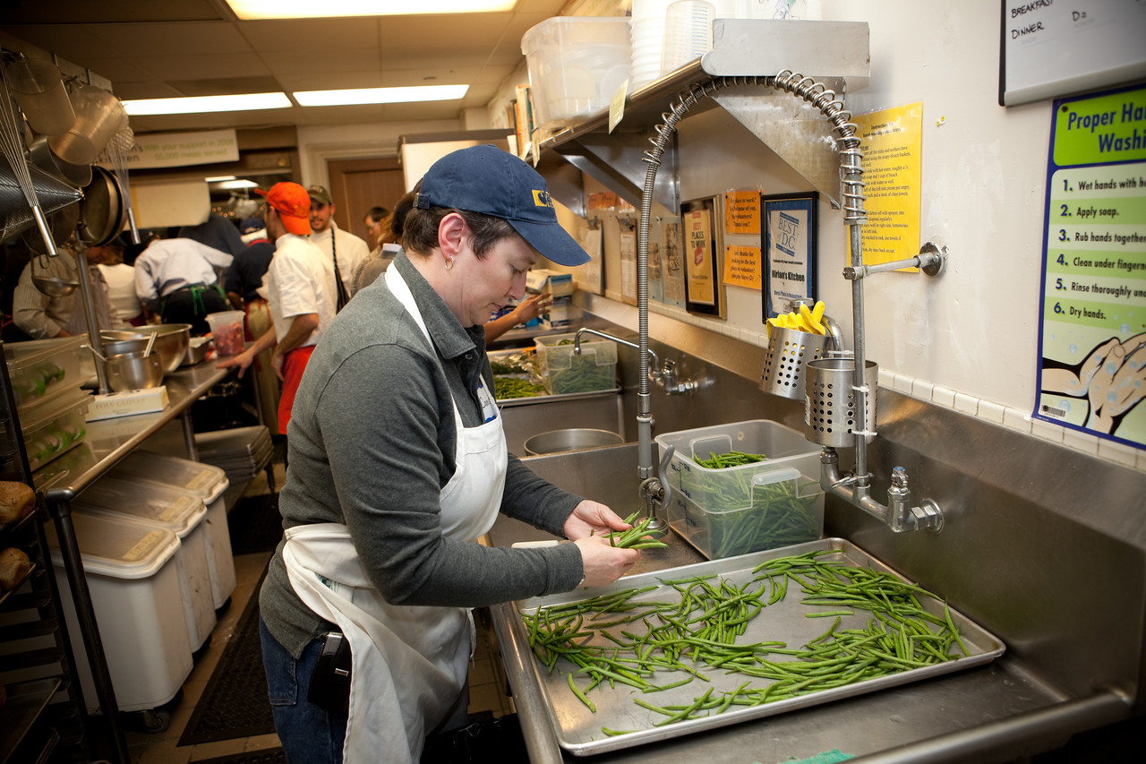 MLK Day, January 18, 2010: A volunteer prepares food that will be served to homeless people at Miriam's Kitchen.