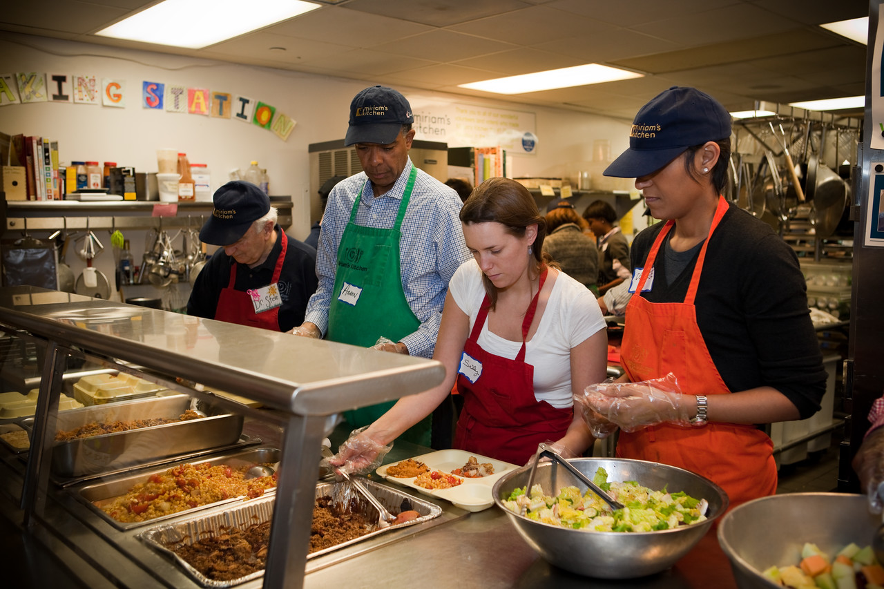 MLK Day, January 18, 2010: Peace Corps Director Aaron S. Williams, second from left, joined other Peace Corps staff to feed homeless people at Miriam's Kitchen in Washington, DC.