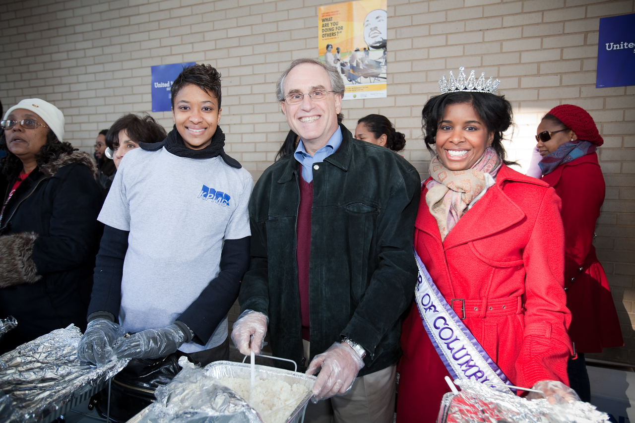 MLK Day, January 18, 2010: A volunteer joins Stan Soloway, center, a member of the Board of Directors of the Corporation for National and Community Service, and Ms. District of Columbia Jen Corey in serving meals to homeless people at the Martin Luther King, Jr. Memorial Library.