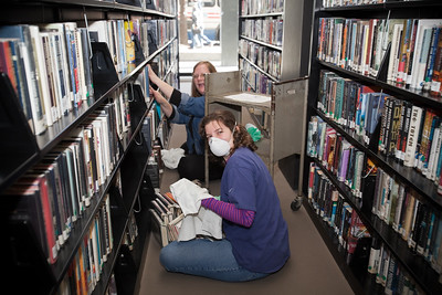 MLK Day, January 18, 2010: Volunteers dust and re-shelve books at the Martin Luther King, Jr. Memorial Library.