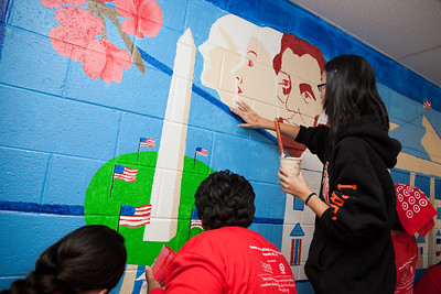 MLK Day, January 18, 2010: Volunteers examine the Washington, DC, themes included in a mural they painted at TC Williams High School's Minnie Howard campus.