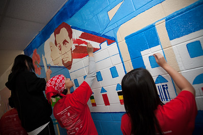 MLK Day, January  18, 2010: Volunteers add color and brightness to the walls of TC Williams High School's Minnie Howard campus with education-themed murals.