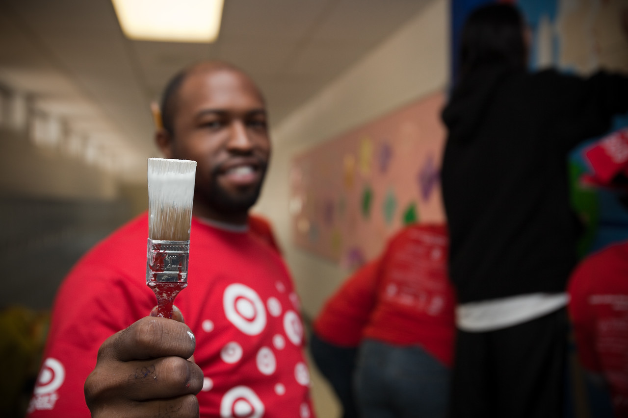 MLK Day, January 18, 2010: Volunteer Marcus Gray displays the paintbrush he used to brighten TC Williams High School's Minnie Howard campus.