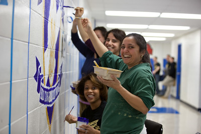 Volunteers work on a school beautification project during the 2011 Martin Luther King Jr Day of Service in Washington, DC.