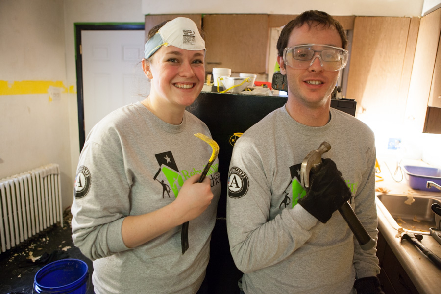 AmeriCorps members with Rebuilding Together serve on MLK Day 2014. Photo by Henry Scott..