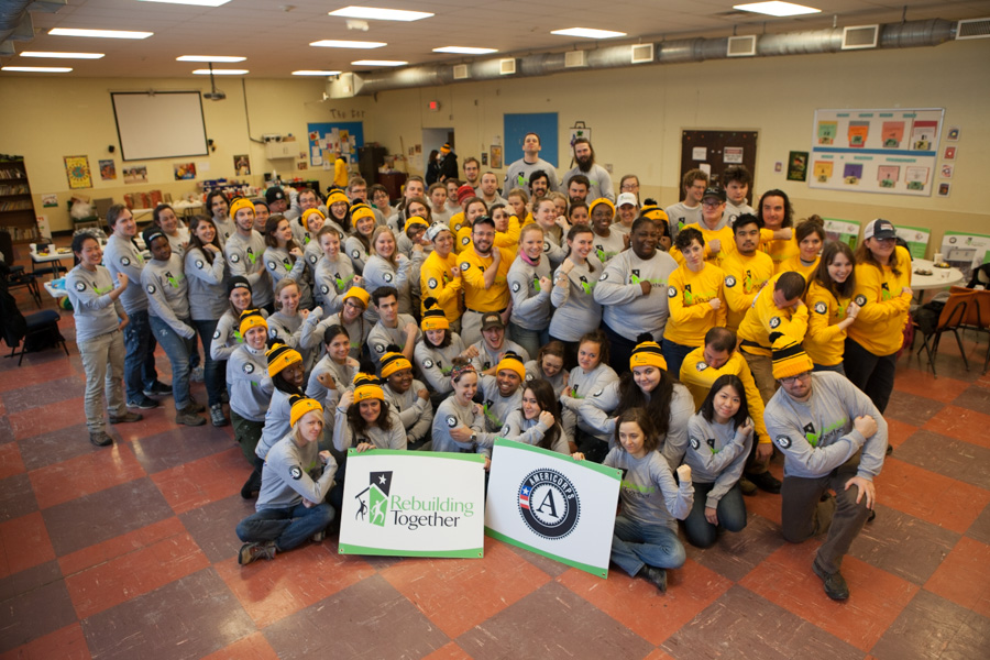 AmeriCorps members with Rebuilding Together celebrate a successful service day on MLK Day 2014 in Pittsburgh, PA. Photo by Henry Scott.