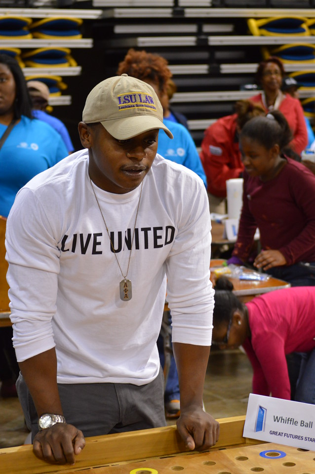 A volunteer at the Capital Area United Way service event in Baton Rouge, LA on MLK Day 2014.