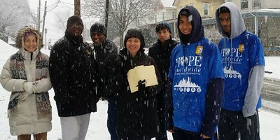 Hope Worldwide volunteers working in a snowstorm in Cincinnati, Ohio reached over 86,000 households with information about fire safety on MLK Day 2014.