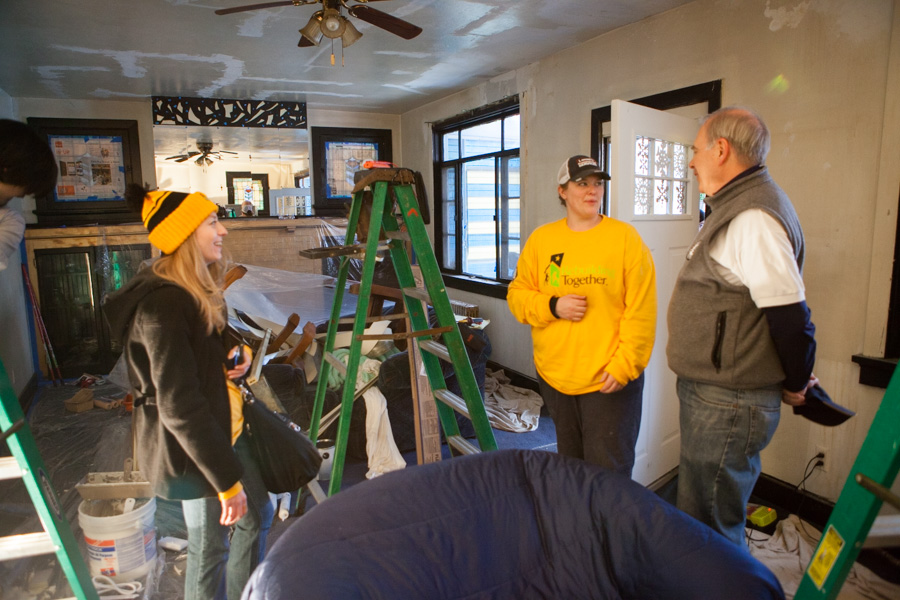 Director of AmeriCorps Bill Basl and AmeriCorps members with Rebuilding Together refurbish a house on MLK Day 2014. Photo by Henry Scott.