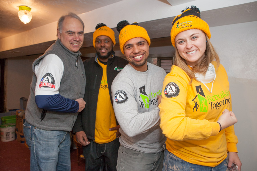 Director of AmeriCorps Bill Basl and AmeriCorps members with Rebuilding Together serving on MLK Day 2014. Corporation for Photo by Henry Scott.