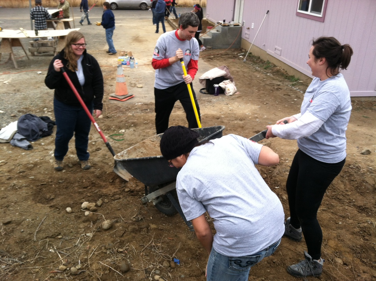 (left to right) Jesuit Volunteer Corps Northwest AmeriCorps members Corbin Weaver, James Wykowski, Jordan Matulis, and Caitlin Cervenka work with Habitat for Humanity on the foundation of a new home in Wenatchee, Washington on MLK Day 2014.