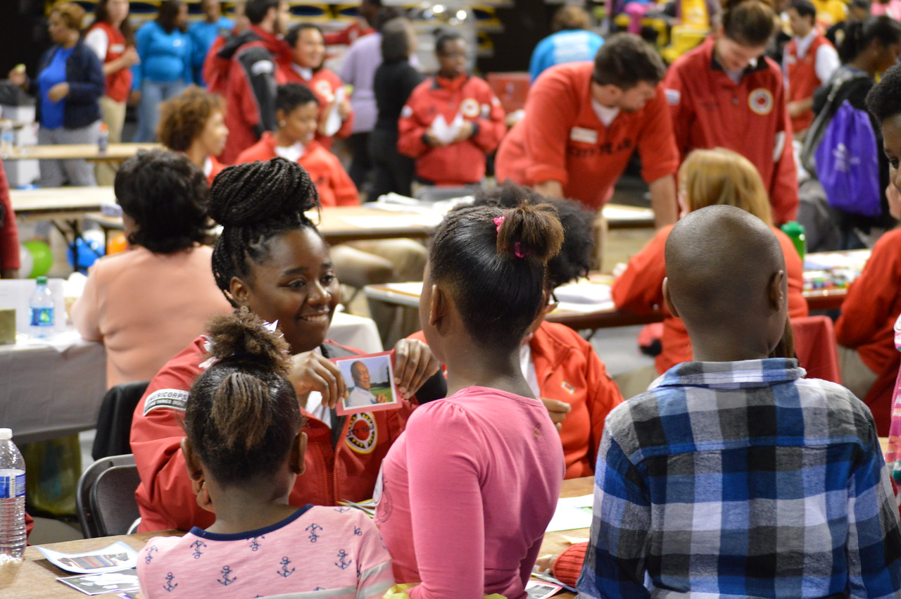 City Year AmeriCorps members help young volunteers at the Capital Area United Way service event in Baton Rouge, LA on MLK Day 2014.