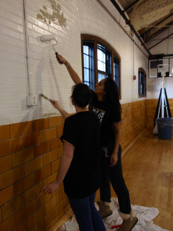 Volunteers paint a gym at Massachusetts College of Liberal Arts MLK Day 2014. Corporation for National and Community Service Photo.
