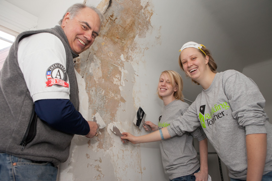 Director of AmeriCorps Bill Basl and AmeriCorps members with Rebuilding Together serving on MLK Day 2014. Photo by Henry Scott.