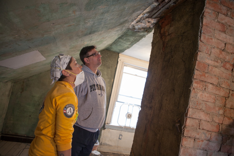 AmeriCorps members with Rebuilding Together serve on MLK Day 2014. Photo by Henry Scott.