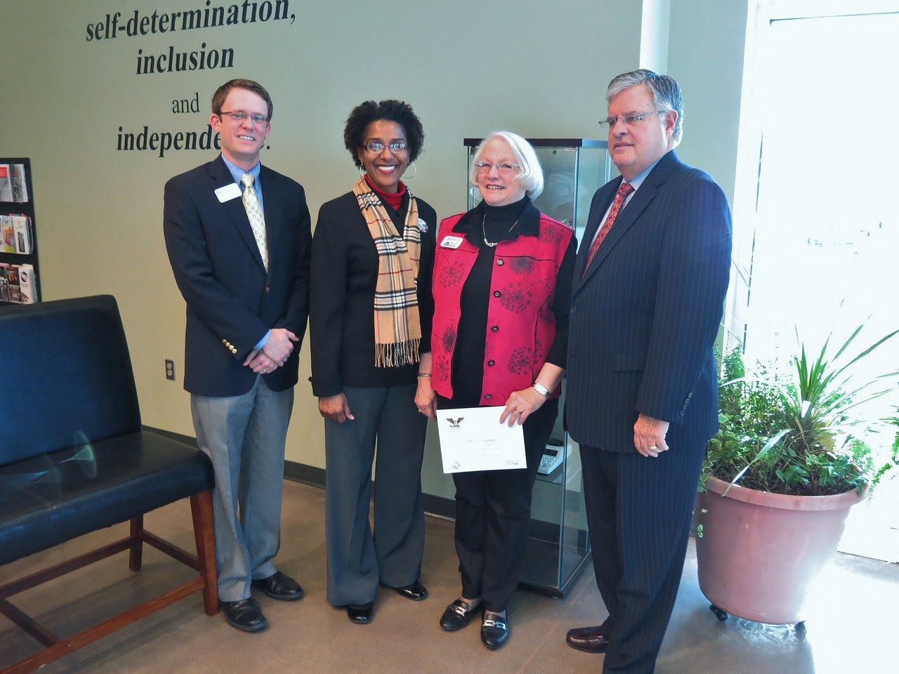 Senior Corps volunteer Nancy Good with RSVP of Southwest Missouri received the Drum Major for Service award on MLK Day 2014 in recognition of her 40 years of service to the Joplin, MO community.<br /> <br /> Left to right: Rep. Billy Long staff member Jake Heisten, Joplin Mayor Melodee Colbert Keen, Nancy Good, and Missouri State Senator Ron Richards.